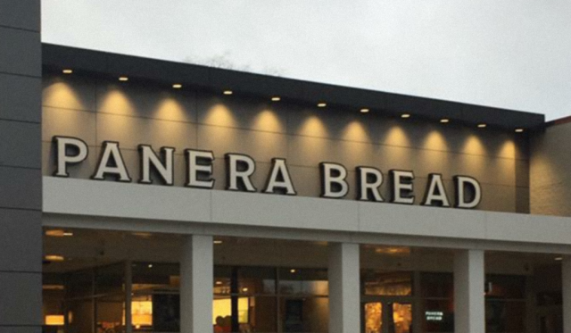Tan and white illuminated ACM Paneling installed on entry way of a Panera Bread restaurant