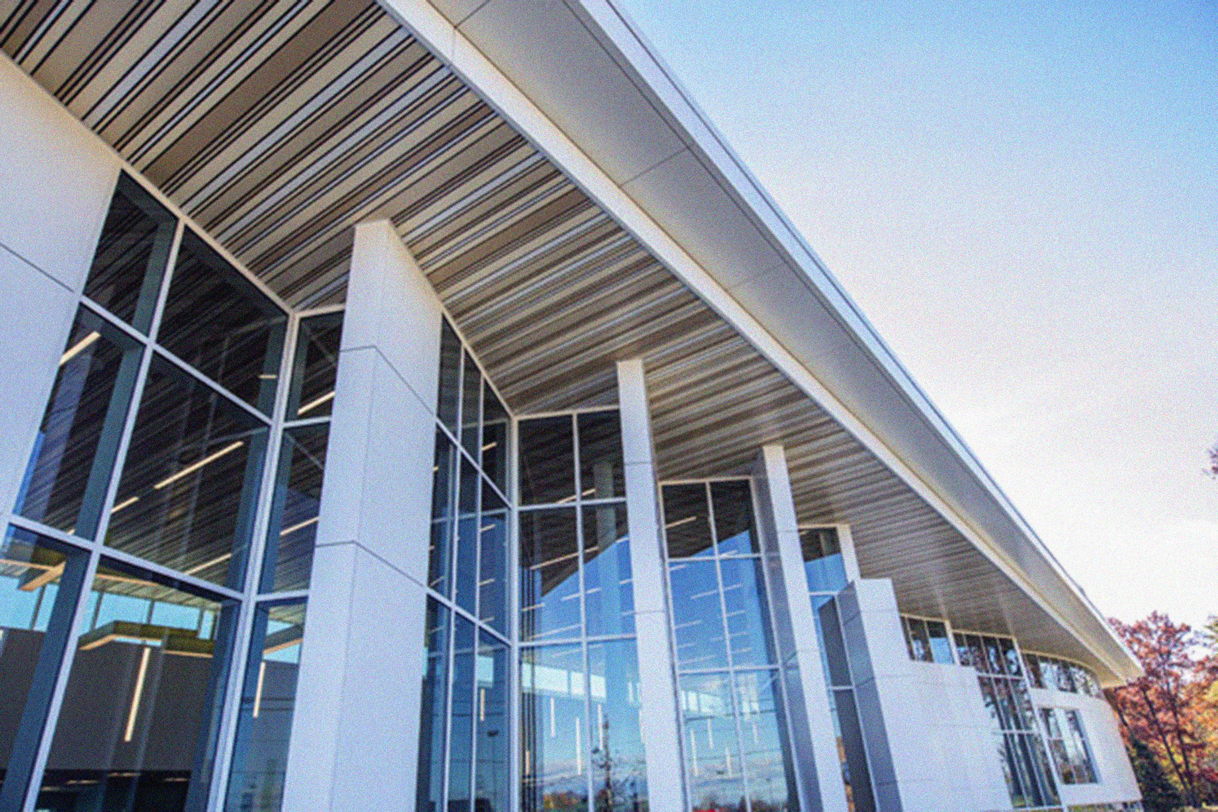 White aluminum composite construction featured on the exterior of a library in Ohio. ACM highlights and accents floor to ceiling windows.