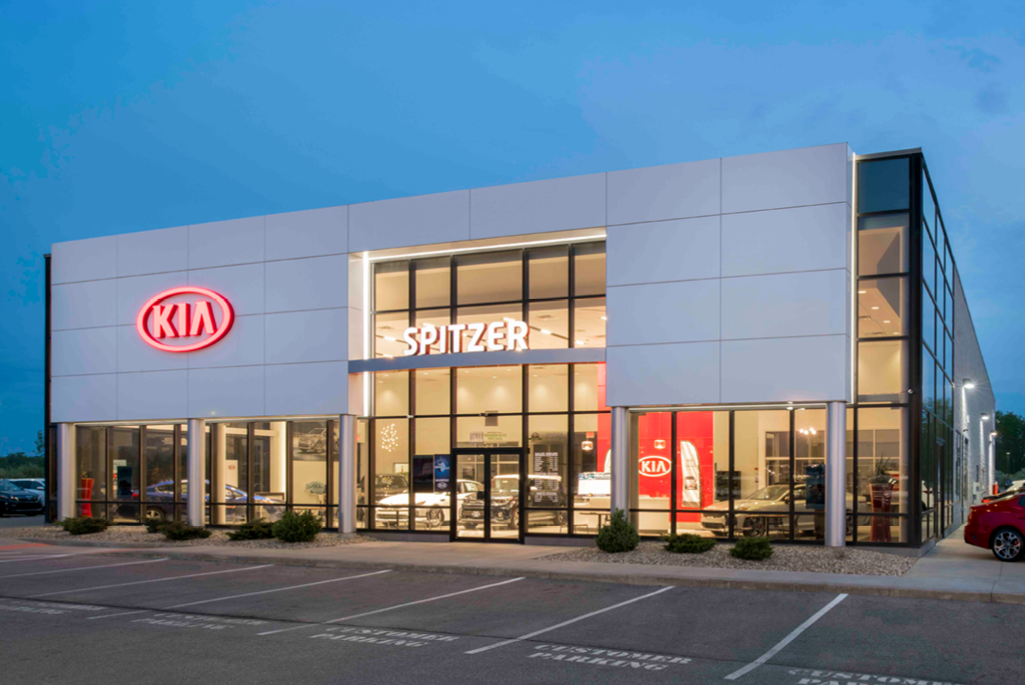 White Aluminum composite paneling construction on the front of a Spitzer, Kia Dealership in Ohio
