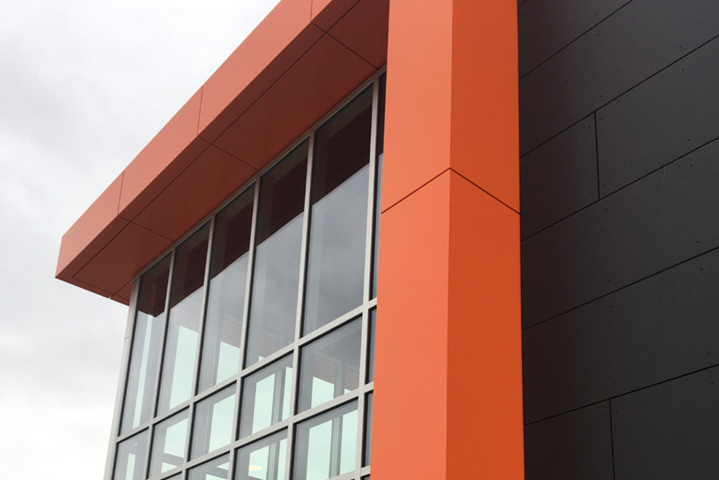 Close up image of the orange and black metal building panels installed at Heidelberg University Campus in Tiffin, Ohio
